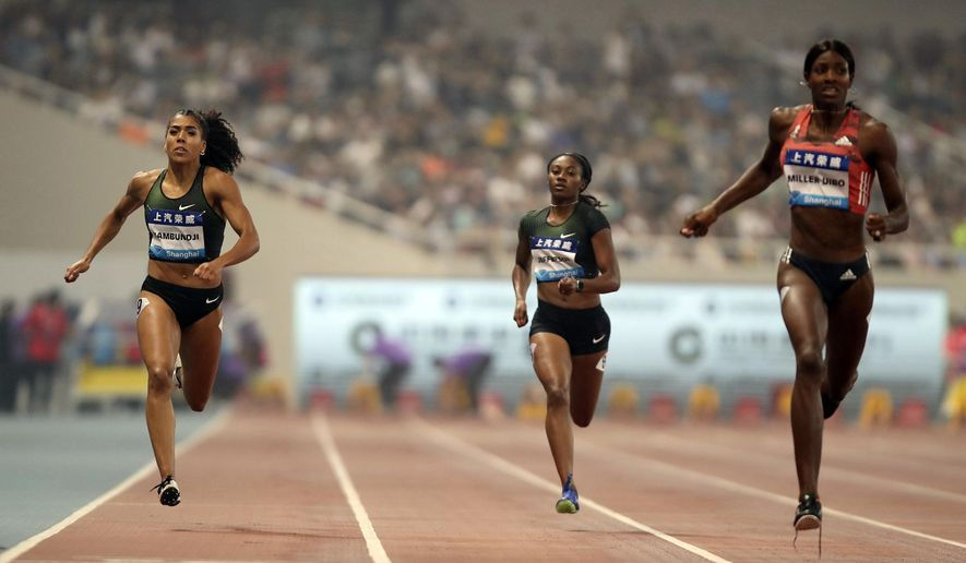Mujinga Kambundji of Switzerland, left, Kyra Jefferson of the United States, center, and Shaunae Miller-Uibo of the Bahamas, right, compete during the women's 200 meters at the Shanghai Diamond League track and field competition in Shanghai, China, Saturday, May 12, 2018. (AP Photo)
