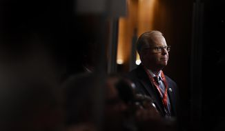 Danbury Mayor and Republican candidate for governor Mark Boughton moves through the crowd of delegates at the State Republican Convention, Saturday, May 12, 2018, in Mashantucket, Conn. Connecticut Republicans are gathering for a second consecutive day to finish endorsing their slate of candidates for the November elections, including the hotly contested race for governor. (AP Photo/Jessica Hill)