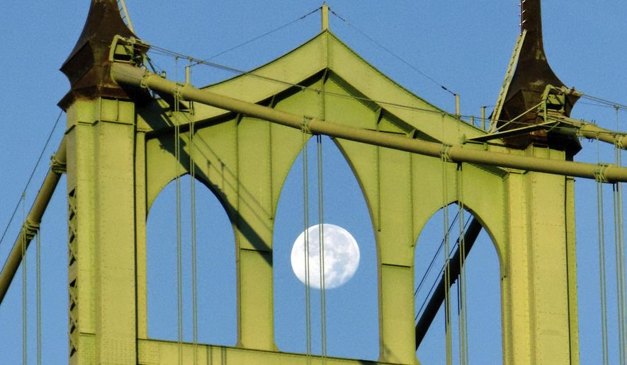 """FILE - In this Sept. 2, 2012, file photo, the moon hangs over St. John's Bridge at Cathedral Park in Portland, Ore. Drive across Oregon and it's hard not to notice that many of the state's steel bridges, from the foggy coast to high desert, are the same shade of sage green. It's so ubiquitous that the paint's manufacturer calls it """"ODOT Green"""" after Oregon's Department of Transportation (Mike Zacchino/The Oregonian via AP, File)"""