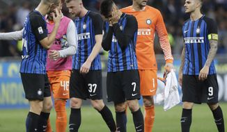Inter Milan players leave the pitch at the end of the Serie A soccer match between Inter Milan and Sassuolo at the San Siro stadium in Milan, Italy, Saturday, May 12, 2018. Sassuolo won 2-1. (AP Photo/Luca Bruno)