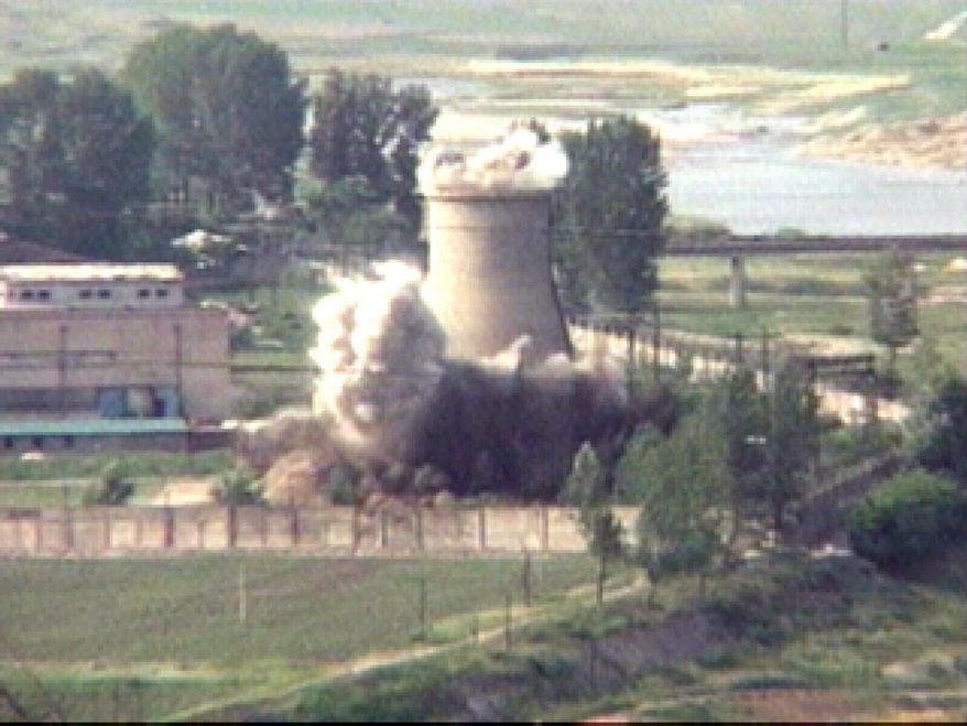 """In this June 27, 2008, file image from TV,  the demolition of the 60-foot-tall cooling tower at its main reactor complex in Yongbyon North Korea. North Korea's Foreign Ministry said Saturday May 12, 2018, it will hold a """"ceremony"""" for the dismantling of its nuclear test site on May 23-25 in what would be a dramatic but symbolic event to set up the summit meeting between Kim Jong-un and U.S. President Donald Trump scheduled for next month. (AP Photo/APTN, File)"""