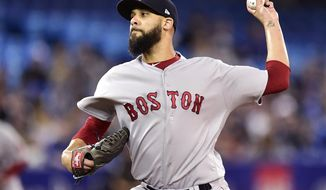 Boston Red Sox starting pitcher David Price (24) works against the Toronto Blue Jays during the first inning of a baseball game in Toronto on Saturday, May 12, 2018.  (Frank Gunn/The Canadian Press via AP)