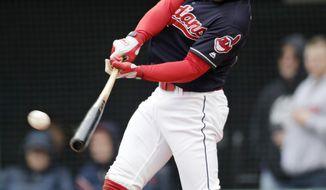 Cleveland Indians' Francisco Lindor hits a solo home run off Kansas City Royals starting pitcher Jakob Junis in the third inning of a baseball game, Saturday, May 12, 2018, in Cleveland. (AP Photo/Tony Dejak)