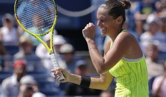 FILE - In this  Sunday, Sept. 4, 2016 filer, Roberta Vinci, of Italy, reacts after winning her match with Lesia Tsurenko, of Ukraine, during the fourth round of the U.S. Open tennis tournament, in New York. Former U.S. Open finalist Roberta Vinci will have no regrets when she plays her final match at next week's Italian Open. The 35-year-old Vinci announced in November that she would conclude her career before her home fans at the Foro Italico. (AP Photo/Kathy Willens, File )