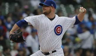 Chicago Cubs starting pitcher Jon Lester throws against the Chicago White Sox during the first inning of a baseball game Saturday, May 12, 2018, in Chicago. (AP Photo/Nam Y. Huh)