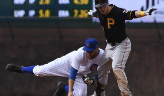 FILE - In this April 12, 2018, file photo, Chicago Cubs second baseman Ben Zobrist, left, misses the tag on Pittsburgh Pirates Corey Dickerson, right, at second base during the ninth inning of a baseball game in Chicago. Major League Baseball has warned Zobrist of the against wearing black cleats. Zobrist posted a letter from the league office on Instagram saying the cleats he wore May 2 against Colorado violated the collective bargaining agreement. (AP Photo/Matt Marton, File)