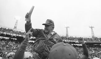 Seattle Seahawks coach Chuck Knox,  is obviously happy as he is carried from the field after his Seahawks defeated the Miami Dolphins in the AFC-Semi-Finals at Miami on Saturday, Dec. 31, 1983 with a score of 27-20.(AP Photo)