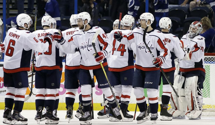 The Washington Capitals celebrate their 6-2 win over the Tampa Bay Lightning during Game 2 of the NHL Eastern Conference finals hockey playoff series Sunday, May 13, 2018, in Tampa, Fla. (AP Photo/Chris O'Meara)