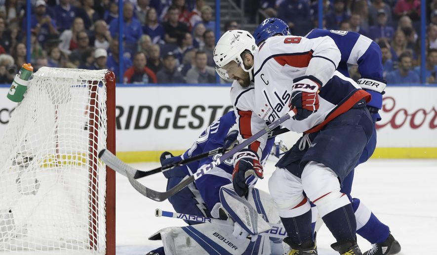 Washington Capitals left wing Alex Ovechkin (8) shoots wide of Tampa Bay Lightning goaltender Andrei Vasilevskiy (88) during the first period of Game 2 of the NHL Eastern Conference finals hockey playoff series Sunday, May 13, 2018, in Tampa, Fla. (AP Photo/Chris O'Meara)