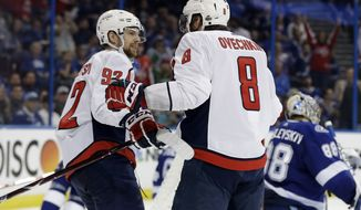 Washington Capitals left wing Alex Ovechkin (8) celebrates with center Evgeny Kuznetsov (92) after Ovechkin scored against the Tampa Bay Lightning during the third period of Game 2 of the NHL Eastern Conference finals hockey playoff series Sunday, May 13, 2018, in Tampa, Fla. The Capitals won the game 6-2. (AP Photo/Chris O'Meara)