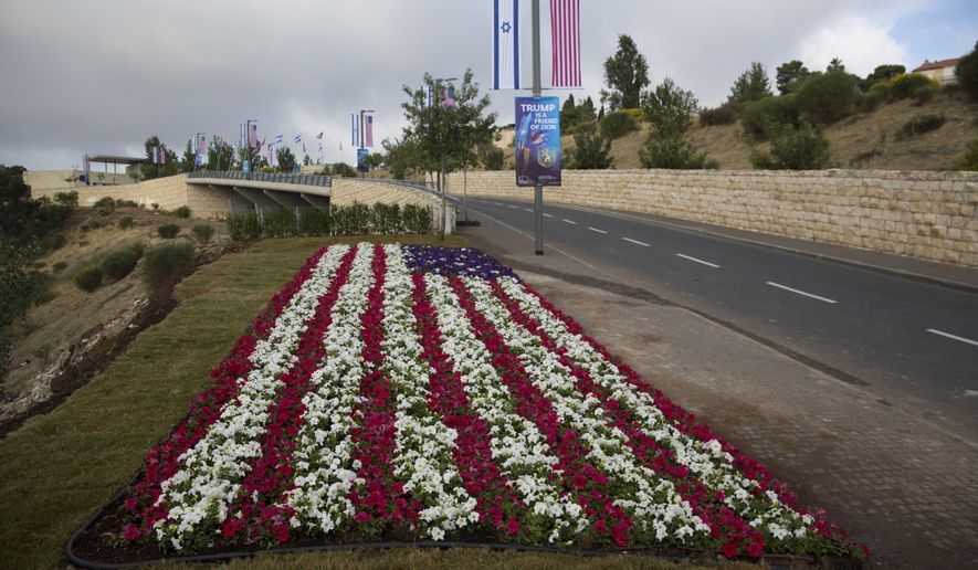 Flowers decorated as an American flag have been planted along a road leading to the U.S. Embassy compound in Jerusalem. The embassy will be inaugurated Monday, five months after President Trump recognized Jerusalem as Israel's capital. (Associated Press)