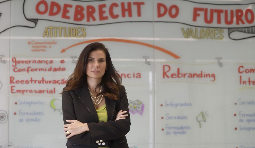 In this April 12, 2018 photo, Olga Pontes, chief compliance officer at construction company Odebrecht, poses for a photo after an interview with The Associated Press, at the company's headquarters in Sao Paulo, Brazil, Thursday, April 12, 2018. While Odebrecht, who ran one of Latin Ameica's most brazen bribery schemes, appears to have made much progress toward changing its culture of corruption, questions remain about the influence of the Odebrecht family and whether the firm can regain trust, particularly abroad. (AP Photo/Andre Penner)