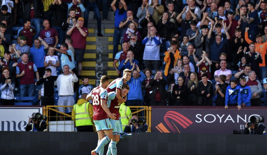 Burnley's Chris Wood, bottom, celebrates scoring his side's first goal of the game during their English Premier League soccer match against AFC Bournemouth at Turf Moor, Burnley, England, Sunday, May 13, 2018. (Anthony Devlin/PA via AP)