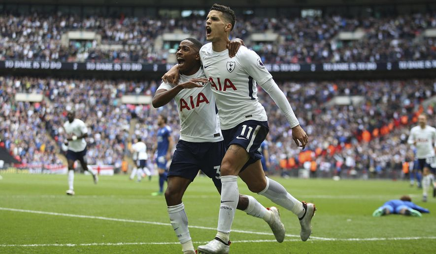 Tottenham Hotspur's Erik Lamela, foreground, celebrates scoring his side's forth goal of the game with teammate Danny Rose during the English Premier League soccer match between Tottenham Hotspur and Leicester City, at Wembley Stadium, in London, Sunday May 13, 2018. (Steven Paston/PA via AP)