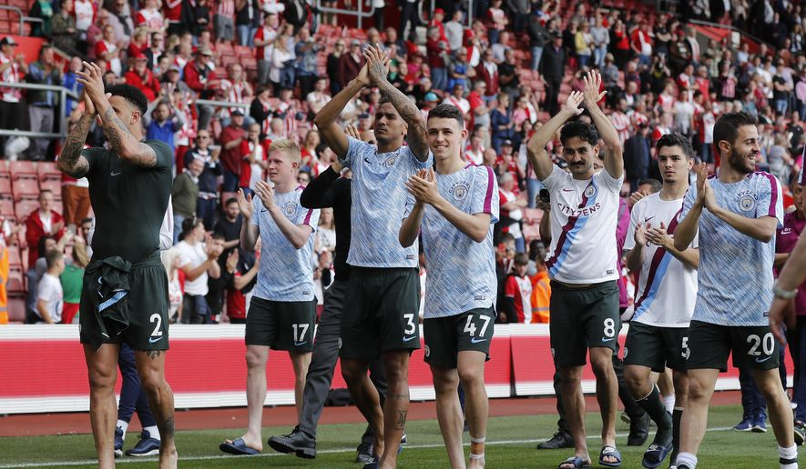 Manchester City teammates celebrate with supporters after scoring the English Premier League soccer match between Southampton and Manchester City at St Mary's Stadium in Southampton, Sunday, May 13, 2018. (AP Photo/Frank Augstein)