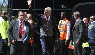 Arsenal manager Arsene Wenger arriving for his final match in charge before the English Premier League soccer match between Huddersfield Town and Arsenal at the John Smith's Stadium, Huddersfield, England, Sunday, May 13, 2018. (Mike Egerton/PA via AP)