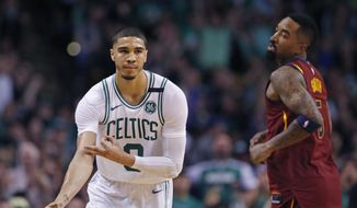 Boston Celtics forward Jayson Tatum (0) celebrates his three-point basket as Cleveland Cavaliers guard JR Smith (5) looks on during the second quarter of Game 1 of the NBA basketball Eastern Conference Finals, Sunday, May 13, 2018, in Boston. (AP Photo/Michael Dwyer)