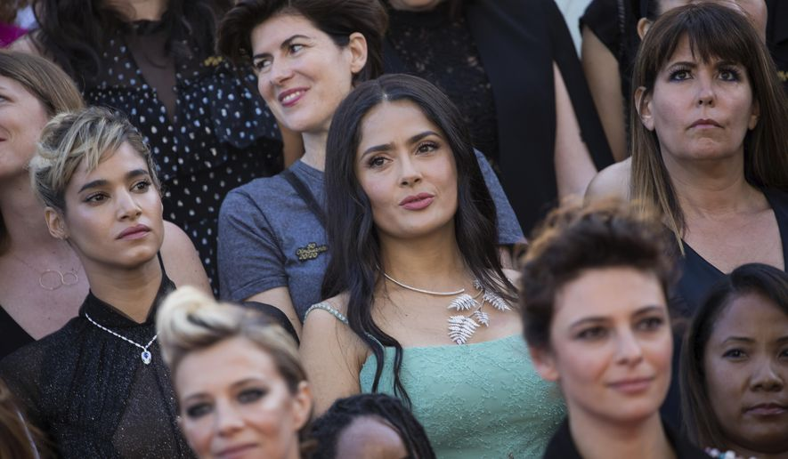Sofia Boutella, from centre left, Salma Hayek and Patty Jenkins stand as part of 82 film industry professionals on the steps of the Palais des Festivals to represent, what they describe as pervasive gender inequality in the film industry, at the 71st international film festival, Cannes, southern France, Saturday, May 12, 2018. Since the Cannes Festival was created, 82 films directed by women have been included in official competition, whilst 1,645 films directed by men were selected. (Photo by Vianney Le Caer/Invision/AP)