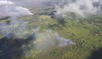 This Saturday, May 12, 2018, aerial image released by the Hawi'i County Fire Department, show a view of fissure 16, bottom right, that erupted this morning beginning just before 7:00 a.m. HST in the Big Island of Hawaii. The fissure is located roughly along the alignment of the earlier fissures, steam in top left photo, and 1.3 km (0.8 miles) northeast of fissure 15 and Pohoiki Road. Warnings that Hawaii's Kilauea volcano could shoot boulders and ash out of its summit crater are prompting people to rethink their plans to visit the Big Island. But most of the rest of the island is free of volcanic hazards, and local tourism officials are hoping travelers will recognize the Big Island is ready to welcome them. (Hawi'i County Fire Department via AP)
