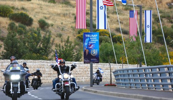 Riders from the Samson Riders, an Israeli motorcycle club, arrive on a road leading to the new U.S. Embassy during a group ride from the old embassy in Tel Aviv, ahead of the official opening, in Jerusalem, Sunday, May 13, 2018. On Monday, the United States moves its embassy in Israel from Tel Aviv to Jerusalem, the holy city at the explosive core of the Israeli-Palestinian conflict and claimed by both sides as a capital. (AP Photo/Ariel Schalit)