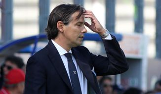 Lazio coach Simone Inzaghi touches his forehead during the  Serie A soccer match between Crotone and Lazio at Ezio Scida stadium in Crotone, Italy, Sunday May 13,  2018. (Albano Angiletta/ANSA via AP)