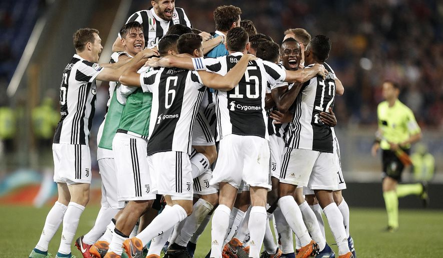 Juventus players celebrate at the end of the Serie A soccer match between Roma and Juventus, at the Rome Olympic stadium, Sunday, May 13, 2018. The match ended in a scoreless draw and Juventus won record-extending seventh straight Serie A title.  (Riccardo Antimiani/ANSA via AP)