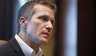 FILE - In this Jan. 20, 2018, file photo, Missouri Gov. Eric Greitens listens to a question during an interview in his office at the Capitol in Jefferson City, Mo., where discussed having an extramarital affair before taking office. Jury selection is taking longer than expected in the criminal trial of Greitens. Opening arguments had been expected to begin Monday, May 14. Instead, attorneys who began screening prospective jurors last week are to continuing doing so Monday. (AP Photo/Jeff Roberson, File)