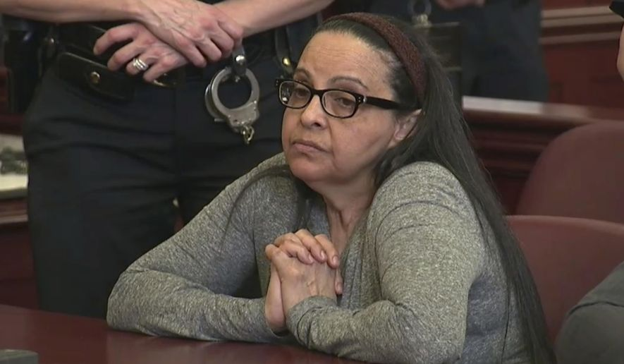 FILE - In this March 1, 2018 file image from video, Yoselyn Ortega, a trusted nanny to a well-to-do family, listens to court proceedings during the first day of her trial,in New York. Ortega is set to be sentenced on Monday, May 14, 2018, following her conviction of murder last month in the 2012 deaths of Lucia and Leo Krim. (WYNY-TV/Pool Photo via AP, File)