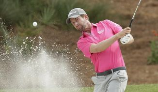 Webb Simpson hits from an eighth hole sand trap, during the final round of the The Players Championship golf tournament Sunday, May 13, 2018, in Ponte Vedra Beach, Fla. (AP Photo/John Raoux)