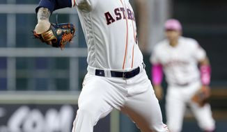 Houston Astros starting pitcher Dallas Keuchel throws against the Texas Rangers during the first inning of a baseball game Sunday, May 13, 2018, in Houston. (AP Photo/Michael Wyke)