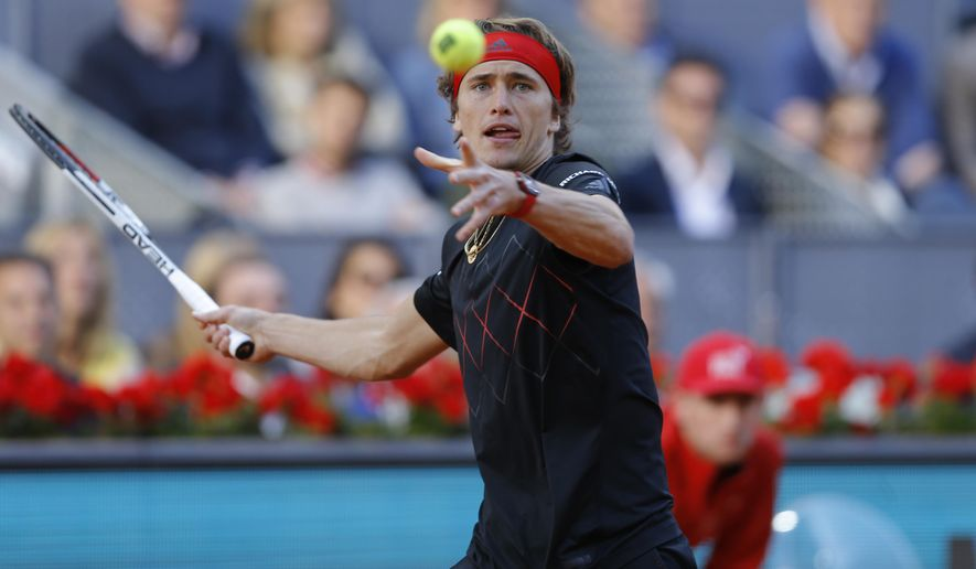 Alexander Zverev of Germany returns the ball to Dominic Thiem of Austria during the men's final of the Madrid Open Tennis tournament in Madrid, Spain, Sunday May 13, 2018. (AP Photo/Francisco Seco)