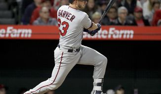 Minnesota Twins' Mitch Garver watches his RBI-double against the Los Angeles Angels during the 12th inning of a baseball game in Anaheim, Calif., Saturday, May 12, 2018. The Twins won 5-3. (AP Photo/Chris Carlson)