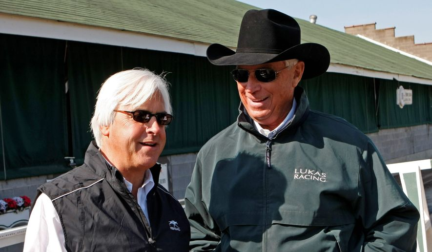 Long-time friends and rival trainers Bob Baffert (left) and D. Wayne Lukas both won the Preakness Stakes six times. Their horses go head-to-head Saturday. (ASSOCIATED PRESS)