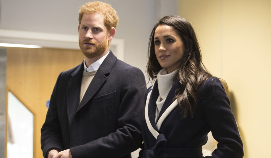 Britain's Prince Harry and his fiancee US actress Meghan Markle  watch Coach Core apprentices taking part in a training masterclass exercise during their to visit the  Nechells Wellbeing Centre in Birmingham central England on Thursday March 8, 2018 to meet Coach Core apprentices.  The Coach Core apprenticeship scheme was designed by The Royal Foundation of The Duke and Duchess of Cambridge and Prince Harry to train young people aged 16 - 24 with limited opportunities to become sports coaches and mentors within their communities.  (Oli Scarff Poool via AP)