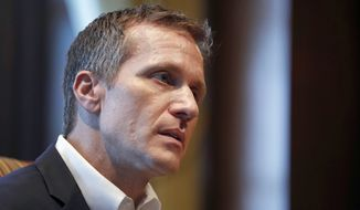 In this Jan. 20, 2018, file photo, Missouri Gov. Eric Greitens listens to a question during an interview in his office at the Capitol in Jefferson City, Mo., where discussed having an extramarital affair before taking office. Jury selection is taking longer than expected in the criminal trial of Greitens. Opening arguments had been expected to begin Monday, May 14. Instead, attorneys who began screening prospective jurors last week are to continuing doing so Monday. (AP Photo/Jeff Roberson, File)