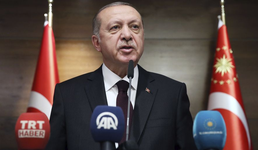 Turkey's President Recep Tayyip Erdogan speaks to Turkish students in London, Monday, May 14, 2018. Erdogan started Sunday a three-day visit to Britain. (Presidential Press Service/Pool via AP)