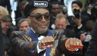Director Spike Lee poses for photographers upon arrival at the premiere of the film 'BlacKkKlansman' at the 71st international film festival, Cannes, southern France, Monday, May 14, 2018. (Photo by Joel C Ryan/Invision/AP)