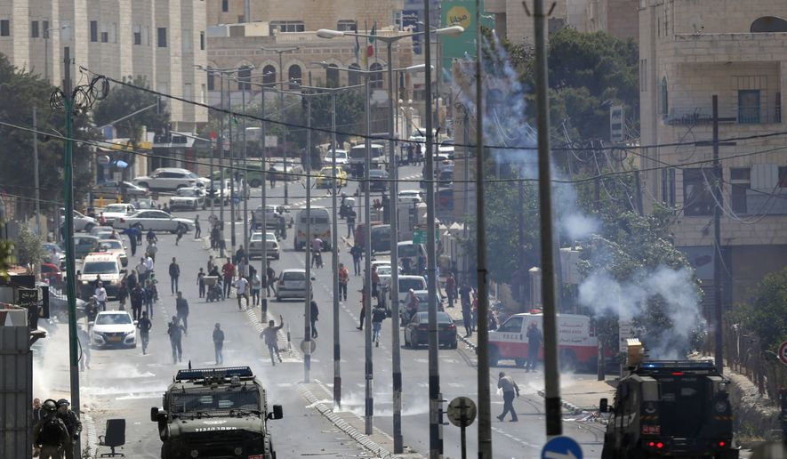 Palestinians clash with Israeli troops following a protest against the opening of the U.S. Embassy in Jerusalem, in the West Bank city of Bethlehem, Monday, May 13, 2018. (AP Photo/Majdi Mohammed)