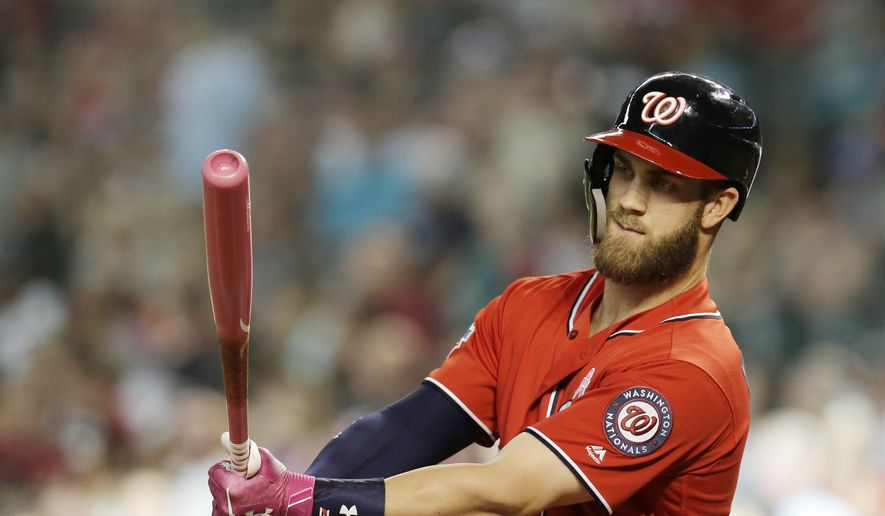 Washington Nationals right fielder Bryce Harper (34) hits a solo homerun in the third inning during a baseball game against the Arizona Diamondbacks, Sunday, May 13, 2018, in Phoenix. (AP Photo/Rick Scuteri) **FiLE**