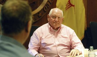 United States Agriculture Secretary Sonny Perdue listens to the concerns of farm and ranch business leaders about Congress' extension of farm support programs and nutrition aid to families in a meeting in Santa Fe, N.M., on Monday, May 14, 2018, in the New Mexico state Capitol. Stakes are high for New Mexico as Congress considers a so-called farm bill that could include new work and job training requirements for food stamps. Perdue heard concern about President Donald Trump's hard-line stance on immigration enforcement and the U.S. trade deficit with China. (AP Photo/Morgan Lee)
