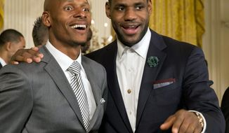 FILE - In this Jan. 14, 2014 file photo then-Miami Heat basketball players Ray Allen, left, and LeBron James look out into the crowd after a ceremony in the East Room of the White House in Washington where President Barack Obama honored the Miami Heat 2013 NBA Champion basketball team. Two-time NBA champion Ray Allen has enjoyed watching his former teammate LeBron James power Cleveland through the playoffs this 2018 spring. Allen said Monday, May 14, 2018 James is leading the way as he has throughout his career. Allen won an NBA title with the Boston Celtics and he teamed with James to win another with the Miami Heat. Allen is part of the newest group of inductees to the South Carolina Athletic Hall of Fame. He played his high school ball in Dalzell, South Carolina. (AP Photo/Jacquelyn Martin, file)