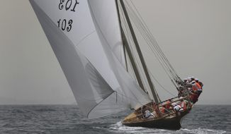 Ghazi, a 60-foot Dhow approaches the finish line to win the $2.7 million Al Gaffal traditional Dhow Race off the coast of Dubai, United Arab Emirates, after starting from the island of Sir Bu Nair about 100 kms (66 miles) west of Dubai, Monday, May 14, 2018. (AP Photo/Kamran Jebreili)