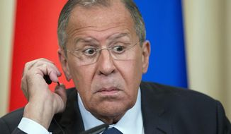 Russian Foreign Minister Sergey Lavrov reacts during his and Egyptian Foreign Minister Sameh Shoukry joint news conference following the talks in Moscow, Russia, Monday, May 14, 2018. Russian and Egyptian officials agreed Monday to expand industrial and military cooperation between the two countries. (AP Photo/Alexander Zemlianichenko)
