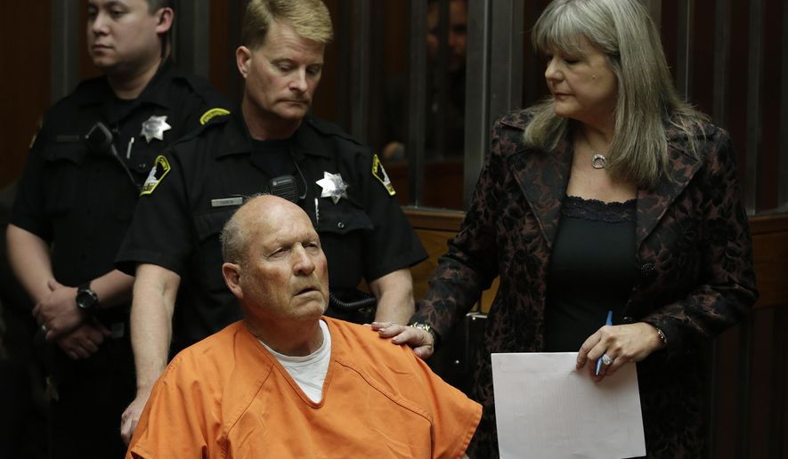 FILE - In this April 27, 2018, file photo, Joseph James DeAngelo, accompanied by Sacramento County Public Defender Diane Howard, right, makes his first appearance to face charges that include homicide and rape, in Sacramento County Superior Court in Sacramento, Calif. A judge is considering whether to make public search and arrest warrants for DeAngelo, a man who authorities call one of California's most elusive serial killers. DeAngelo is due back in court Monday, May 14, for a routine hearing. (AP Photo/Rich Pedroncelli, File)