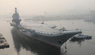 FILE - In this May 13, 2018, file photo provided by China's Xinhua News Agency, China's aircraft carrier leaves Dalian in northeast China's Liaoning Province for sea trials. China's first entirely home-built aircraft carrier has begun sea trials, underscoring how the country is building naval assets to assert its maritime claims in the South China Sea. (Li Gang/Xinhua via AP, File)