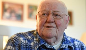 In this April 2018 photo, Stanley L. Evans Sr., of Massillon, Ohio, talks about his military service in Korea, with the Ohio Army National Guard.  Even when he was more than 6,000 miles from home, Evans could still get his hands on his hometown newspaper, The Canton Repository. (Michael Balash/The Canton Repository via AP)