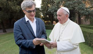 """This image released by Focus Features shows Pope Francis, right, with director Wim Wenders during the filming of the documentary """"Pope Francis: A Man Of His Word."""" (Focus Features via AP)"""