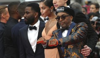 Director Spike Lee, from right, actors Adam Driver, Laura Harrier and John David Washington pose for photographers upon arrival at the premiere of the film 'BlacKkKlansman' at the 71st international film festival, Cannes, southern France, Monday, May 14, 2018. (Photo by Joel C Ryan/Invision/AP)