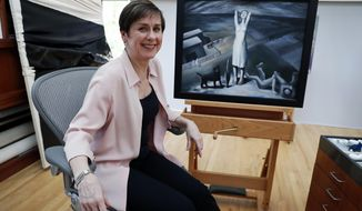 """In this Thursday, April 12, 2018 photo, Sue Canterbury, a curator of American art at the Dallas Museum of Art poses for a photo in front of a painting by Ida O'Keeffe titled """"Spring Lethargy, Texas"""" from 1938, at the DMA in Dallas. The abstract painting of a lighthouse caught the eye of Canterbury as she visited a private collector about five years ago. Struggling to identify the artist, she walked up to the work and looked at the signature. She says she had the same reaction others do when she mentions the artist now, """"Ida O'Keeffe?"""" (AP Photo/Tony Gutierrez)"""