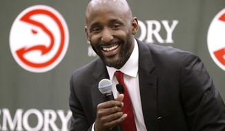 Lloyd Pierce smiles as the Atlanta Hawks introduce him as a full-time coach on Monday, May 14, 2018, in Atlanta. Pierce joins the Hawks after spending the past five seasons as an assistant coach with the 76ers. He also spent time with the Cavaliers, Warriors and Grizzlies organizations. (Curtis Compton/Atlanta Journal-Constitution via AP)